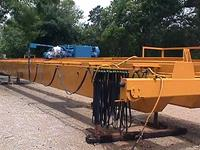 Typical used/refurbished, dual drive, top-riding, long span, double box-girder crane.