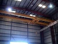 Typical used/refurbished low headroom, top-riding, double girder crane with double girder, underhung trolley.