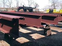 Typical used wide flange crane runway beams with channel cap; used; primer paint.