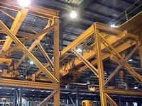 Typical used single girder, 10 ton capacity, semi-gantry cranes before removal and storage.